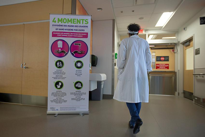 A sign for washing hands is seen during a news media tour of quarantine facilities for treating novel coronavirus at Jewis...
