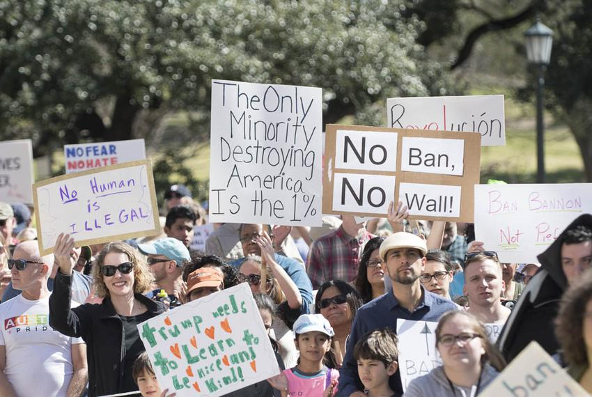 Protesters at the Texas Capitol on Feb. 25, 2017, carry a wide variety of signs denouncing Donald Trump's immigration poli...