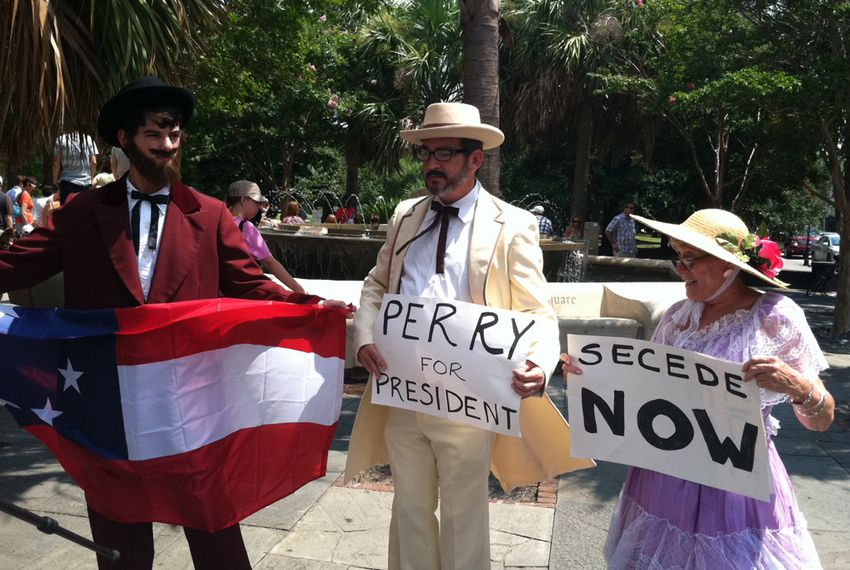 Protesters, dressed in Confederate garb, stage satirical rally in Charleston, South Carolina outside Red State event where Gov. Perry announced his presidential candidacy.