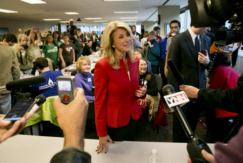 Democratic candidate for Governor of Texas, Sen. Wendy Davis, speaks to press after meeting with volunteers at a phone ban...