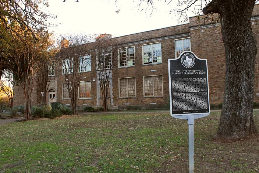A marker from the Texas Historical Commission sits on the front lawn of N. W. Harllee Early Childhood Center. Many residen...