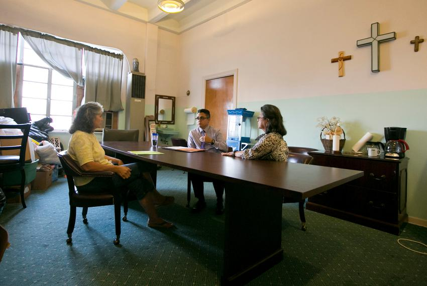 Grandmothers Mercedes Bristol (L) and Delia Martinez meet with with Ray Sauceda, district director for state Rep. Rick Galin…