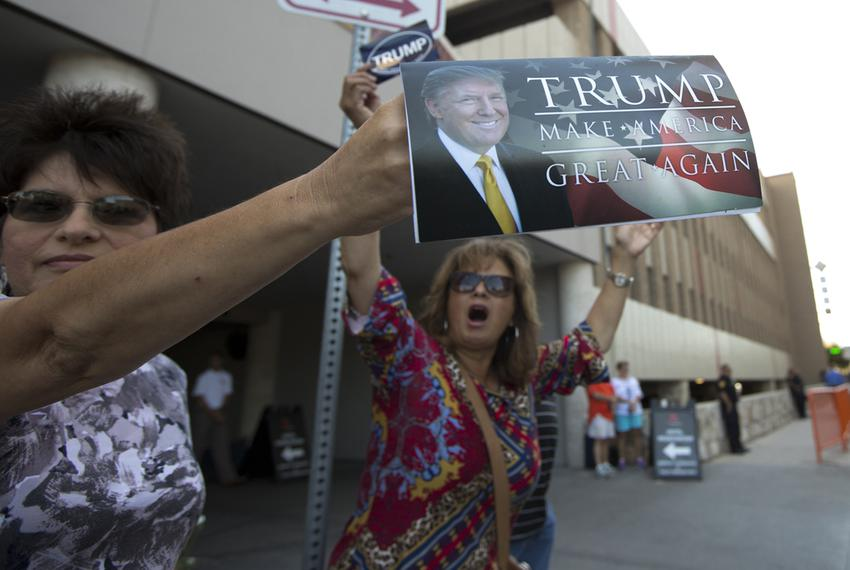 Trump supporters outside the Hyatt Hotel in San Antonio where Republican Presidential nominee Donald Trump was expected to a…