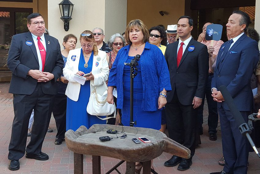"Former state Senator Leticia Van de Putte at the mic. To her left, U.S. Rep. Joaquin Castro, D-San Antonio, and state Sen. Carlos ""Charlie"" Uresti, D-San Antonio, in San Antonio on Oct. 12, 2015."
