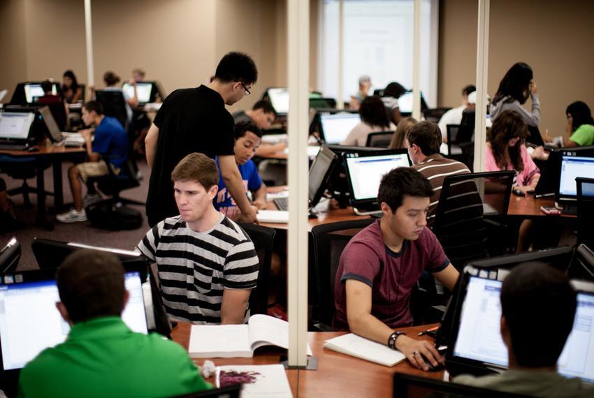 "University of Texas at Arlington students work on college algebra in the university's new ""math emporium"" on Aug. 29, 2012."