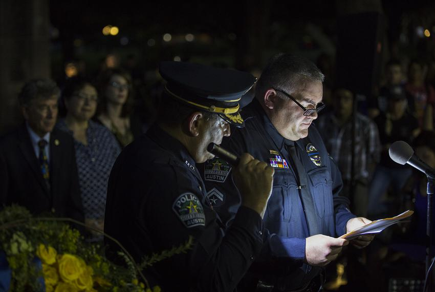 Austin Police Association President Ken Casaday reads a speech during an evening vigil to honor five slain Dallas police off…