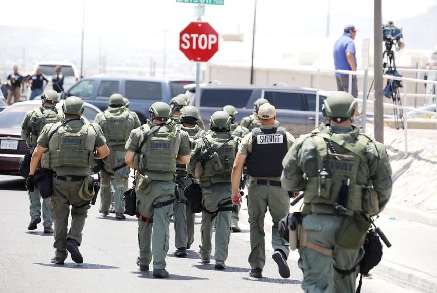 Police near the scene of a mass shooting at a WalMart in El Paso on Saturday, August 3, 2019.