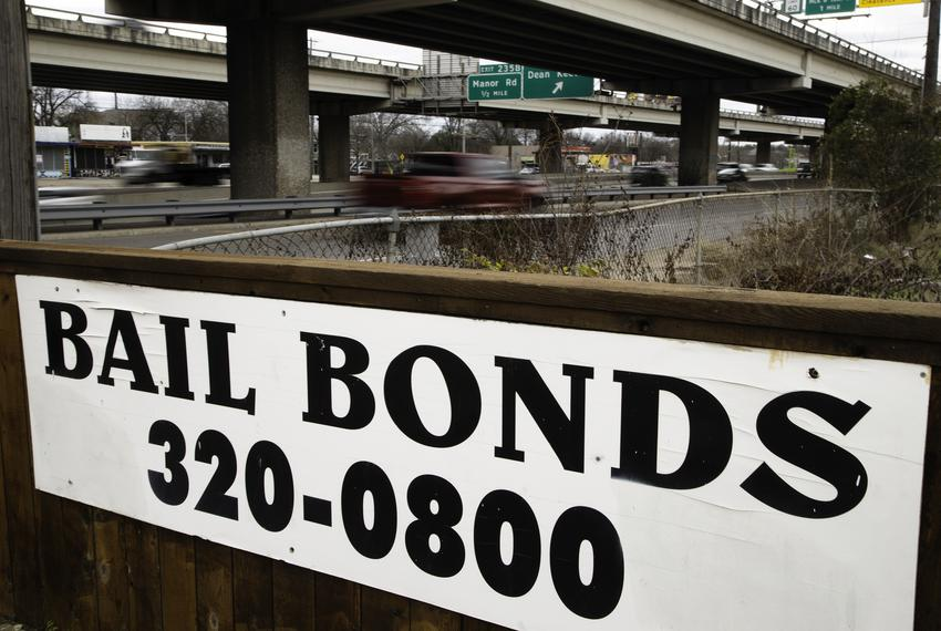 An Austin Bail Bonds II sign near Interstate 35 on Feb. 5, 2021.