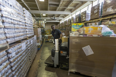 Damon Smith helps unload a truckload of food and supplies at the Southeast Texas Food Bank in Beaumont on Wednesday, Sept. 20, 2017.