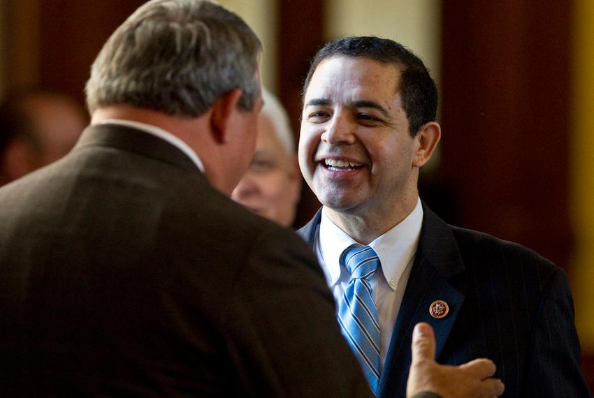 U.S. Rep. Henry Cuellar (D-Laredo) speaks with state Rep. Doug Miller R-New Braunfels, during a visit to the Texas Capitol...