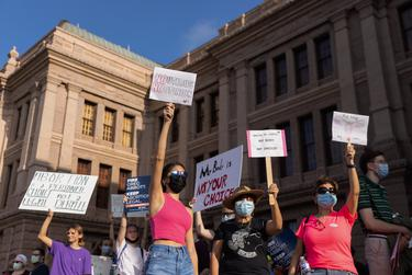 Protestors stood at the front steps of the Capitol in opposition to SB 8 on Oct. 2, 2021.