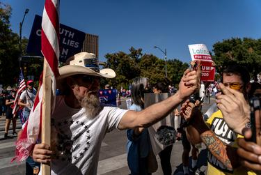 A Trump supporter screams profanities at a group of Biden supporters at the state Capitol in Austin as people turned out after Biden was declared the winner of the 2020 presidential election. Nov. 7, 2020.