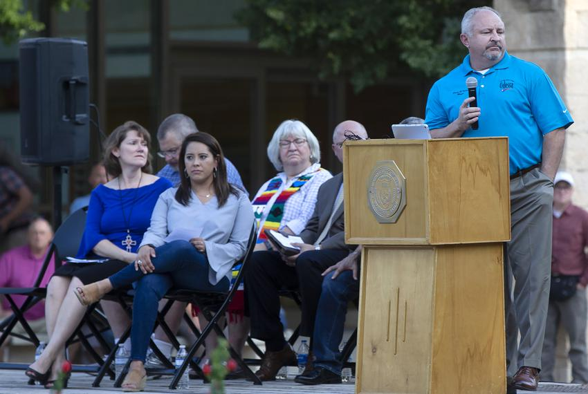 Odessa Mayor David Turner, far right, speaks at a vigil at the University of Texas Permian Basin on Sept. 1, 2019.  The Odes…