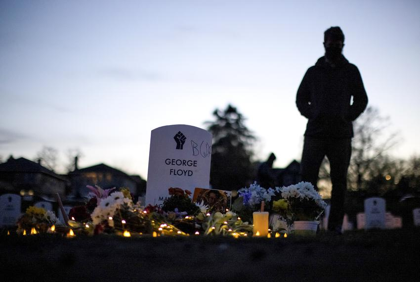 """A person stands at the """"Say Their Names"""" cemetery on the day of the guilty verdict in the trial of former Minneapolis police…"""