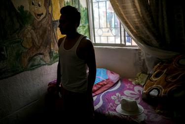 """A young man from Honduras who goes by """"Alexander"""" is seen at a house on the outskirts of town where he has been living since he was sent back to Ciudad Juarez as part of President Trump's """"Remain in Mexico"""" program, Friday, July 19, 2019, in Ciudad Juarez. Photo by Ivan Pierre Aguirre for The Texas Tribune"""