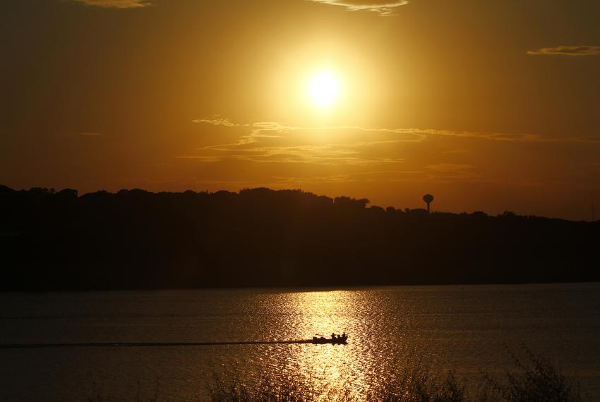 A boat traveled along Lake Travis during a drought in the summer of 2011. Drier than normal weather in Texas with no precipi…