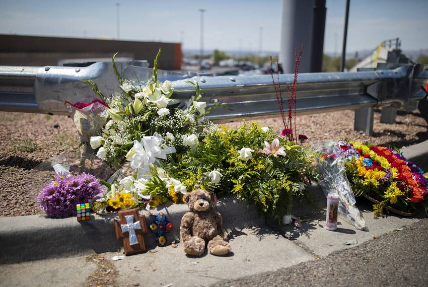 A makeshift memorial is seen at the back entrance to the Walmart where a gunman opened fire on shoppers the day before, Su...