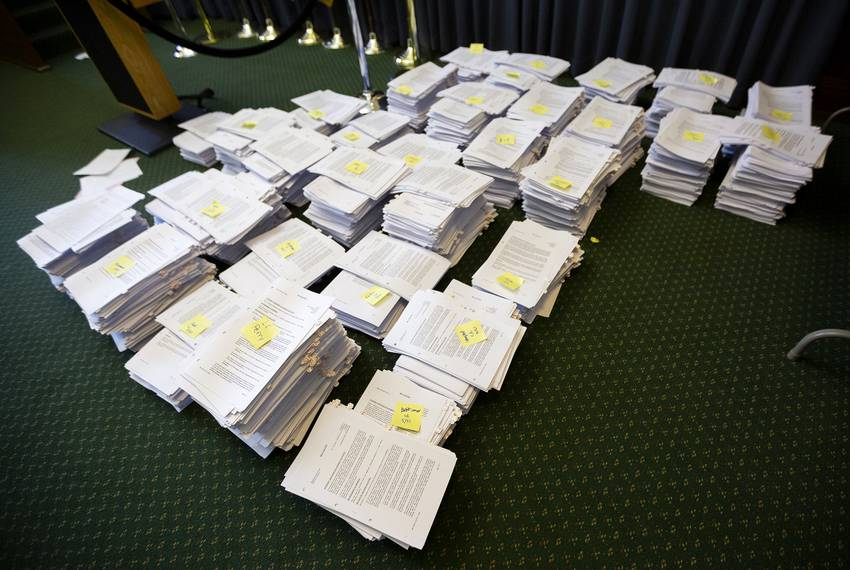 The Sergeant-At-Arms' team prepares bills, mostly House bills, marked on the calendar for the next day on May 21, 2019.