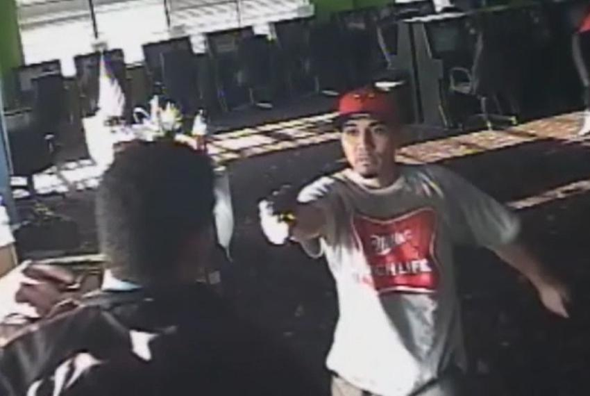 Obed Josafhat Rodriguez is pictured waving a gun on surveillance video taken from the Monroe Game Room in Houston on Aug. ...