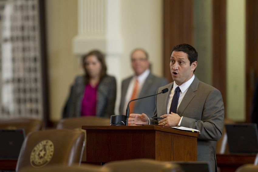 Rep. Trey Martinez Fischer makes a parliamentary inquiry at the back microphone on Feb. 11, 2013.