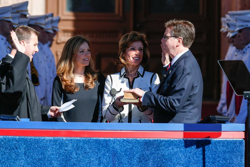 Dan Patrick is sworn in by his son Ryan, a state district judge in Harris County,while his daughter Shane and his wife, Jan,…