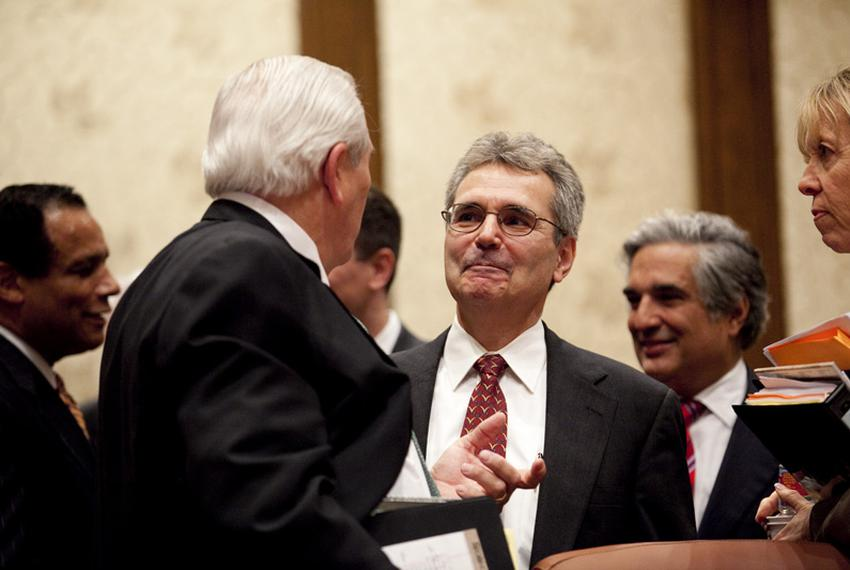 Harvard biologist Dr. Ronald DePinho (r) is greeted by Board of Regents chairman Gene Powell (l) after being named the head …