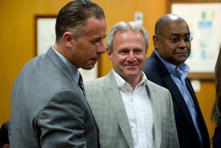 Michael Morton, at the Williamson County Courthouse on April 19, 2013, stands with state Sen. Rodney Ellis, D-Houston, an au…