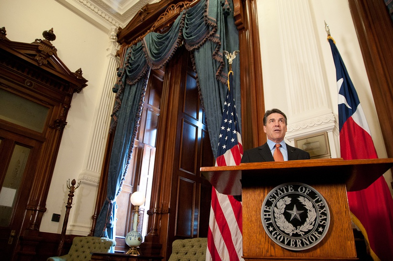 Gov. Rick Perry presents the Governor's Award for Historic Preservation to the Texas Parks and Wildlife Department Wildland Firefighting Teams for their work combating wildfires the state has faced in the past year.