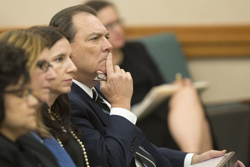"Texas Department of Family and Protective Services Commissioner Henry ""Hank"" Whitman waits to testify during a October 26, 2016 Senate Finance Committee hearing."