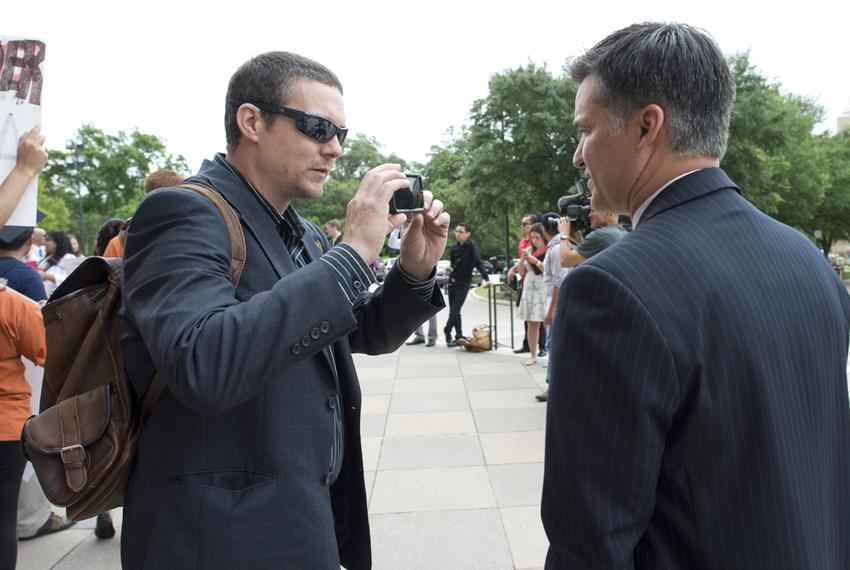 Adam Sharp confronts State Rep. Roland Gutierrez, D-San Antonio, at the Texas Capitol on Thursday, May 21, 2015.