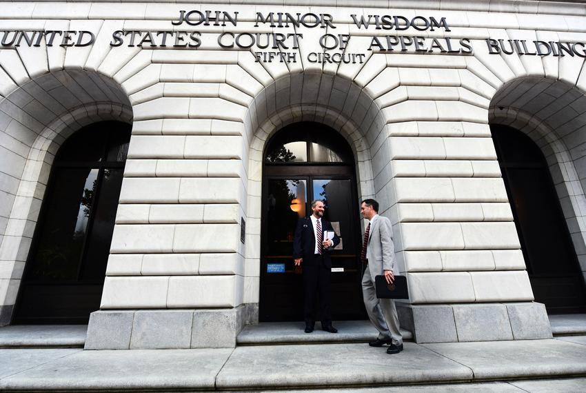 Solicitor General Kyle Hawkins leaves the Fifth Circuit Court of Appeals in New Orleans on Wednesday, Oct. 3, 2018.