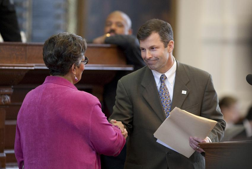 State Rep. David Simpson (r), R-Longview, shakes hands with 'puppy mill' bill sponsor State Rep. Senfronia Thompson (l), D...