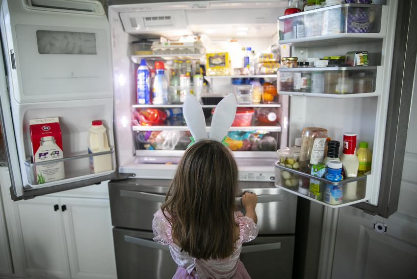 Five-year-old Nora checks out the snack situation during a break in virtual learning in her home in Katy on Monday, Aug. 2...