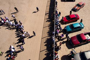 Hundreds of immigrant families and border residents meet at the fence that separates El Paso, left, and Ciudad Juárez on the outskirts of town during a Border Network for Human Rights event welcoming Pope Francis on Feb. 15, 2016.