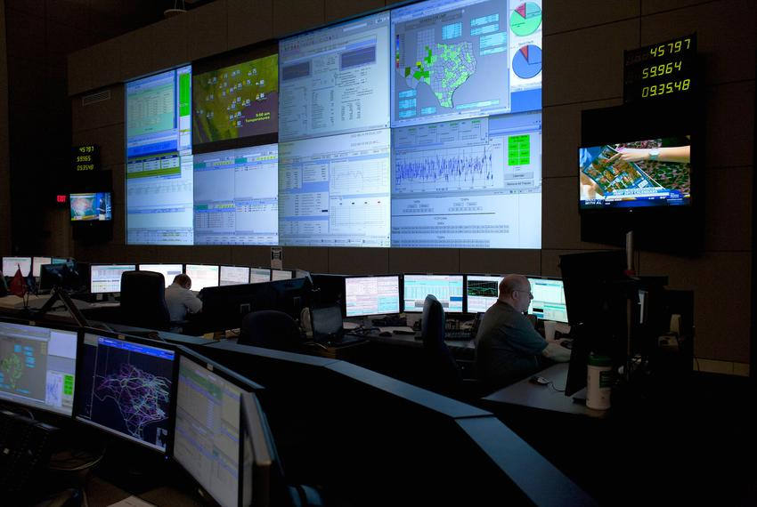 Four reliability coordinators monitor the state power grid during a tour of the Electric Reliability Council of Texas (ERCOT…