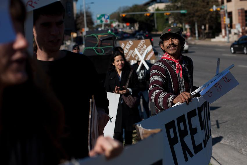 Miguel Rodriguez and other activists march down an Austin, Texas street in support of the jailed political activists who w...