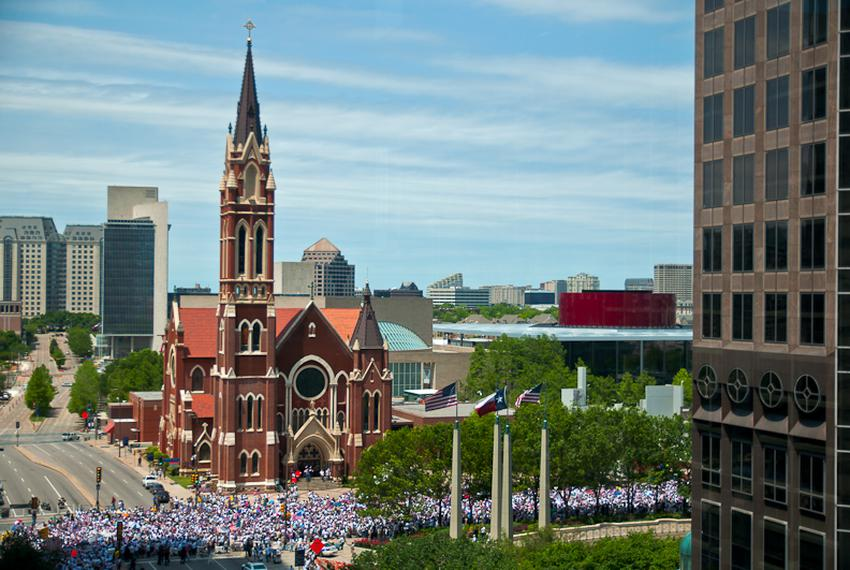 An estimated 25,000 demonstrators march past the Cathedral Shrine of the Virgin of Guadalupe in downtown Dallas.
