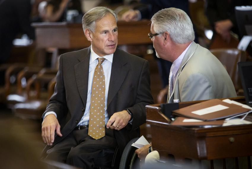 Gov. Greg Abbott chats with state Rep. Dan Huberty, R-Houston, on the House Floor on April 30, 2019.