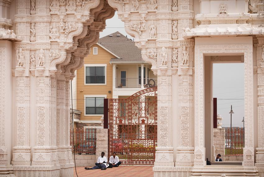 Workers from Rajasthan, India, take a break from cleaning the BAPS Shri Swaminarayan Mandir.