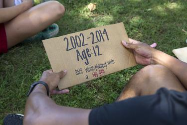 Signs with names of black people who were killed due to police brutality are passed around for protesters to read during a Black Lives Matter Protest at the Hay County Courthouse in San Marcos on June 10, 2020.