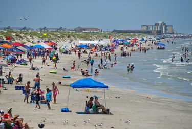 North Padre Island beaches were closed to vehicular traffic July 4, but people still visited Padre Balli Park in Corpus Christi.
