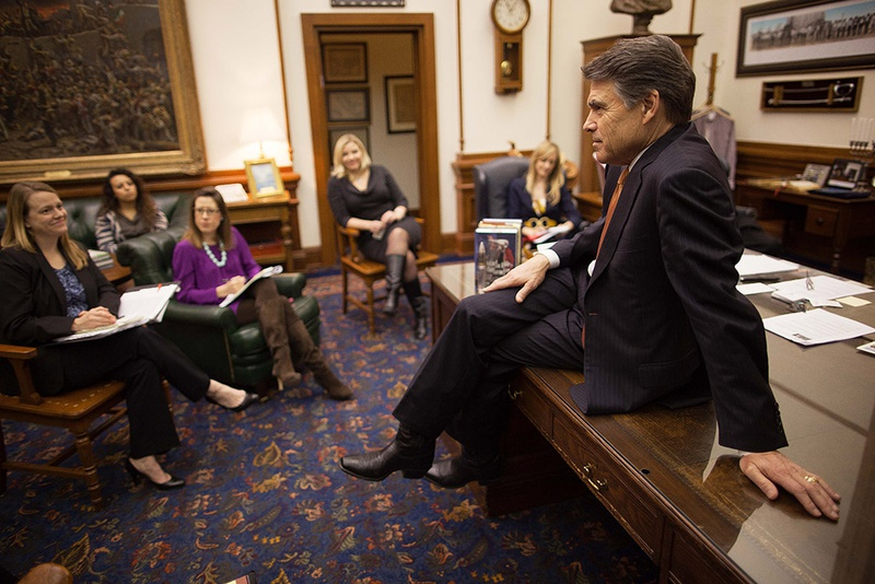 Gov. Rick Perry meets with senior staff members at his office in the state Capitol on Jan. 9, 2013.