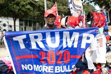 Nathan Quick drove over 1000 miles to be at the rally for President Trump in Dallas at the American Airlines Center on Thursday, he says he follows the President all over the country selling merchandise.