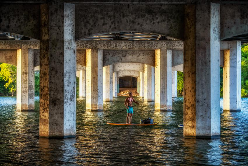 Chelsey Brownfield, 30, and Ryan Encinas, 38, paddle board on Lady Bird Lake in Austin, Texas.  Lady Bird Lake, a 416-acre…