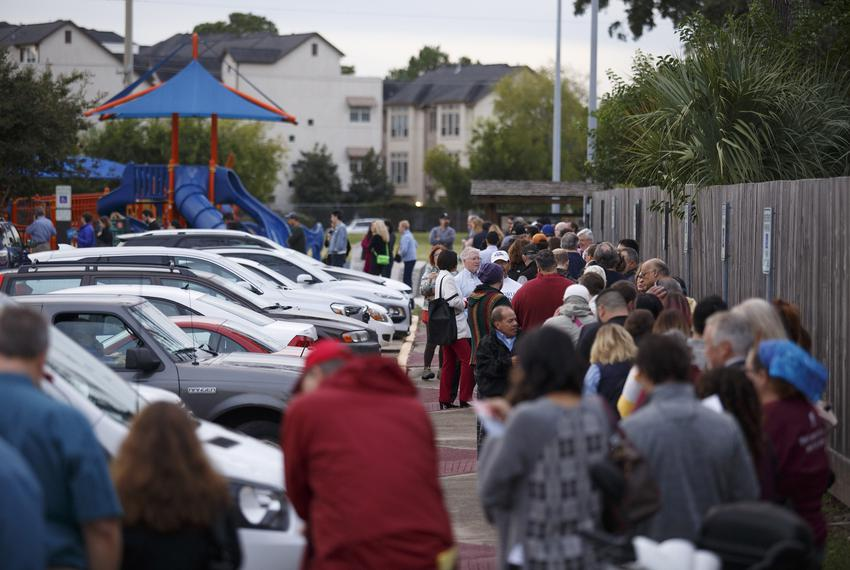 Long lines for the start of early voting snaked around the parking at the Metropolitan Multi-Service Center near downtown ...