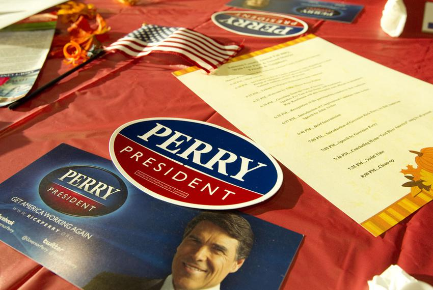 Campaign materials for Gov. Rick Perry at the Johnson County Fall BBQ event in Tiffin, Iowa, where Perry spoke on Oct. 7, 20…