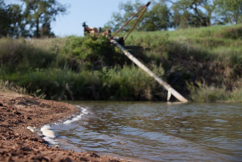 A water pump used for irrigation along the shore of the Brazos River as it flows past Glen Rose, Texas.  Drought conditions have led to a significant decrease in water levels throughout the river, Aug. 3, 2013.