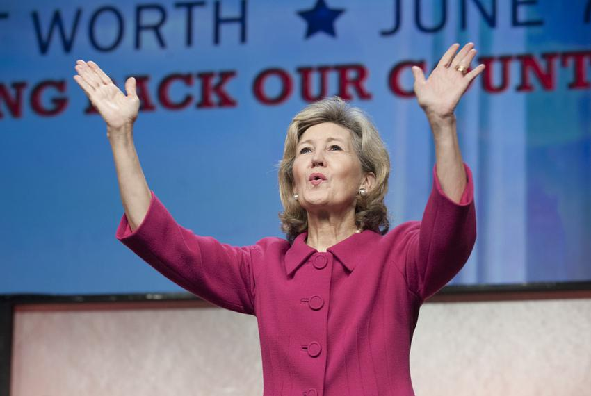 Retiring Texas U.S. Sen. Kay Bailey Hutchison waves goodbye to Texas Republican Convention delegates on June 8, 2012.