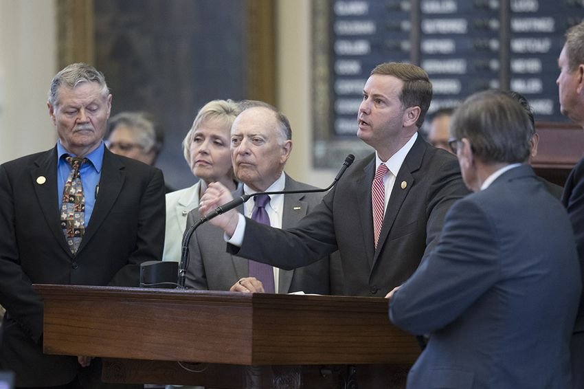 Rep. Trent Ashby, R-Lufkin, speaks on House Bill 20 surrounded by colleagues on the House floor August 1, 2017. The billwould put a one-time influx of $212 million into a health plan that serves hundreds of thousands of retired teachers.