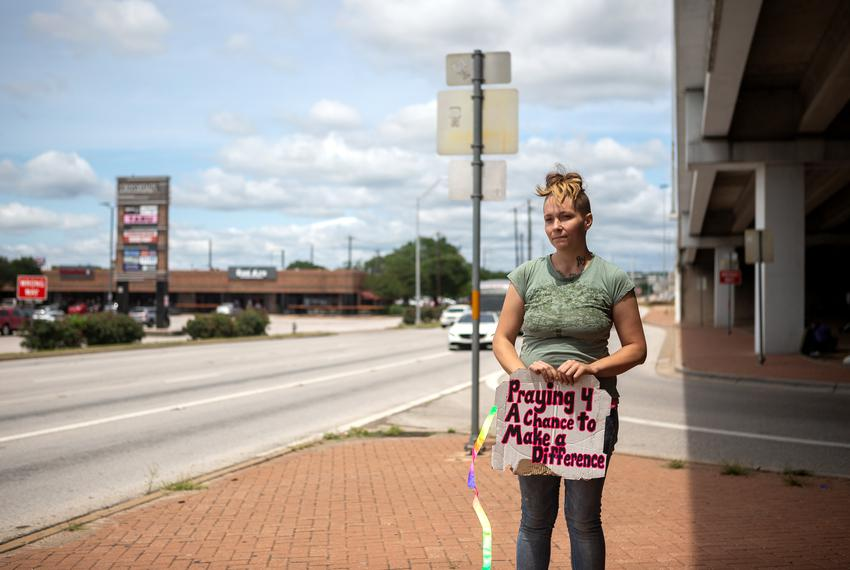 Recently released from jail, Rachel Schuyler panhandles with her dog, Kaido, near the interesection of Burnet Road and U.S. …